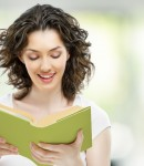 9362648 - young beautiful girl reading a book