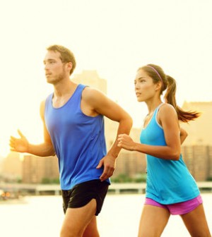 City running couple jogging outside. Runners training outdoors w