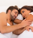 45679642 - a beautiful young passionate couple in bed