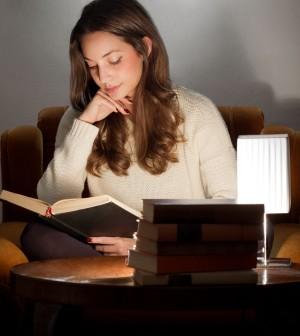 35960082 - portrait of brunette beauty reading books at home.