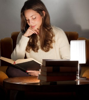 35960082 - portrait of brunette beauty reading books at home.