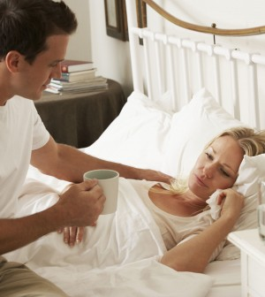 42164344 - husband bringing sick wife hot drink in bed at home